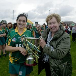 Worth waiting for: Knockananna captain Sinead Byrne accepts the cup from Breda Byrne.
