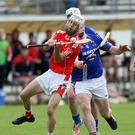 Glenealy's Paul O'Brien gets his shot away as Gerry Connors closes in