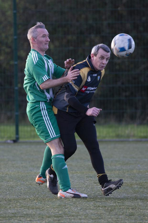Martin Melia and Colm Nugent battle in Berryfield