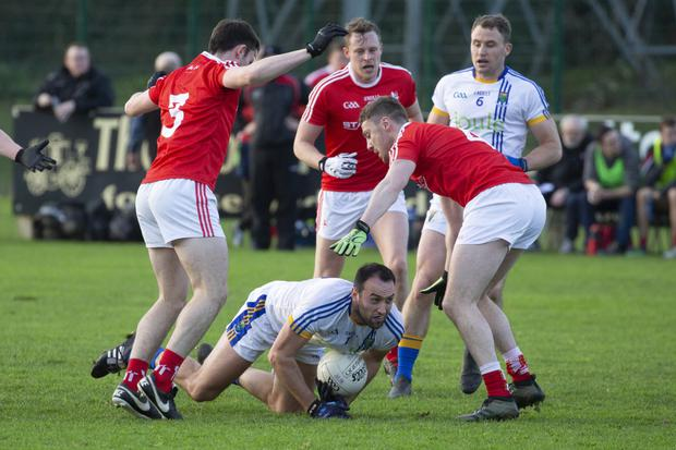 Anthony McLoughlin feels the pressure from the Louth defence
