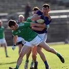 Podge O'Toole tussles with Limerick's Sean McSweeney