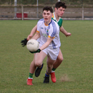 Wicklow Schools captain Mark Reid gets this ball away despite being under pressure from an Offaly Schools opponent