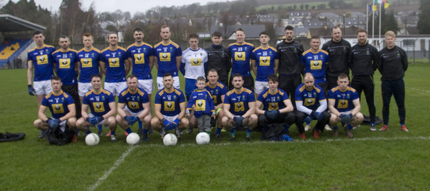 The Wicklow Senior football team with mascot Callum Keogh ahead of their clash with Wexford in Aughrim last Saturday
