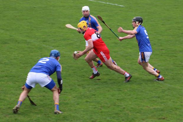 Wicklow's Jack Doyle and Enda Donhoe close in on Derry's Mark McGuigan