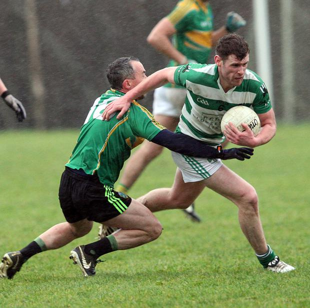 Liam Byrne from Ballymanus brushes off the challenge of Laragh's Myles Conway