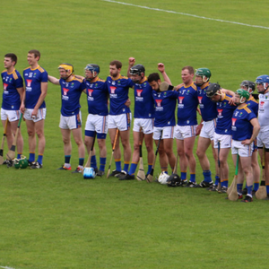 The Wicklow players stand for the national anthem