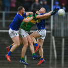 Wicklow's Eoin Murtagh and Darragh Fitzgerald collide with Leitrim's Pearce Dolan in Carrick on Shannon
