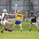 Carnew's Michael Collins clears this ball during the Senior hurling championship in Aughrim