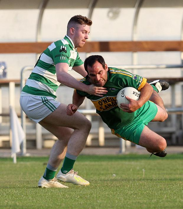 Annacurra's Alan Byrne comes under pressure from Roan Lynch