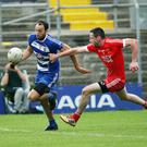 Blessington's Mick McLoughlin goes around Tinahely's Michael Byrne