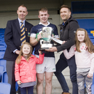 Paudi Reidy of Lightning Protection Ireland presents the cup to Bray Emmets captain Marc Lennon with Wicklow County Chairman Martin Fitzgerald and Paudi's two daughters