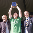 Dunlavin captain Sean Phelan lifts the cup alongside sponsor Patrick Murphy and County Chairman Martin Fitzgerald