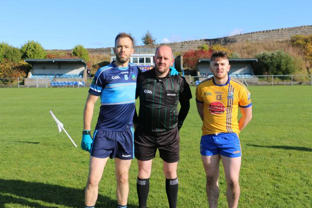 An Tochar's William Halligan, referee David Fedigan and Ballynacargy captain Ryan Maher ahead of the clash in Mullingar on Saturday