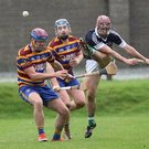 Bray's Cathal O Dulachain boots the ball clear of Scoil Ui Chonaill's Robert Kennedy and Cathal Hardiman