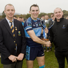 County Chairman Martin Fitzgerald, An Tochar captain Brendan Kennedy and Paul Cullen from the competition sponsors Fitzgerald Kitchens