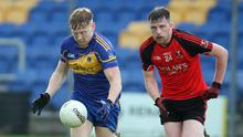 Carnew's Conall McCrea is tracked by Coolkenno's Niall Bailey