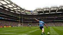 Dean Rock of Dublin kicks a last-minute free during last year's All-Ireland Senior Championship Final match between Dublin and Kerry at Croke Park September 1. Photo: Ramsey Cardy/Sportsfile