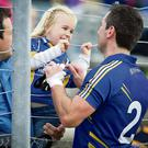 Little Anna Hyland only has eyes for her Uncle and Wicklow Corner back, Ciaran Hyland following the Sligo game in Aughrim. Picture: Garry O'Neill