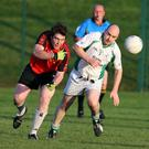 Karl Timmins of Coolkenno and Gerard Daly of Donard keep their eyes on the ball