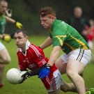 Valleymount's James Fitzpatrick gets his pass away as Kilcoole's Kevin Condron closes in