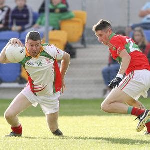 Kiltegan's Derk Daly looks to get past Rathnew's Paul Merrigan during the SFC in Aughrim. Picture: Garry O'Neill