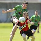 Hollywood's Conor Burke has his shot blocked by Coolkenno's Jim Cushe. Picture: Garry O'Neill