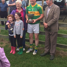 Captain Alan Smyth of Laragh accepting the Cullen Cup from Maire Cullen