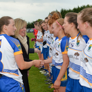 Wicklow captain Sarah Hogan introducing her team-mates to Marie Hickey, President of the LGFA and Sorcha Keane, Lidl, before Division 4 League final.