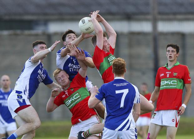St Patrick's and Rathnew battle for possession during their SFC match in Joule Park, Aughrim