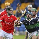 Glenealy's Alan Driver is dispossessed by Bray's Sean Maloney during the SHC in Joule Park, Aughrim
