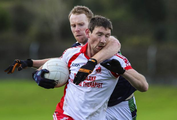 Bray's Rory Breslin challenges Tinahely's Brian Walsh during the Keating Trophy match in Pearse's Park.