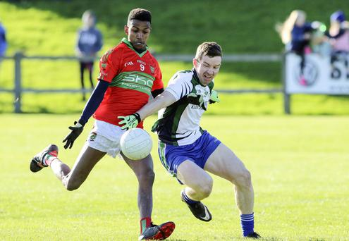 Rathnew's Jonah Graham is challenged by AGB's Stephen Hurley.