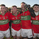 Rathnew's Leighton Glynn, Warren Kavanagh, Damien Power and Graham Merrigan celebrate the final whistle in Aughrim