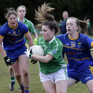 Fermanagh's Naomi McManus tries to escape the attentions of Wicklow's Amy Murphy as Jackie Kinch closes in