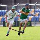 Eoin Keddy of Kilcoole is chased by Sean Somers of Arklow Rock Parnells