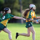 Sive Byrne of Donard is chased by Aimee Maher of Knockananna