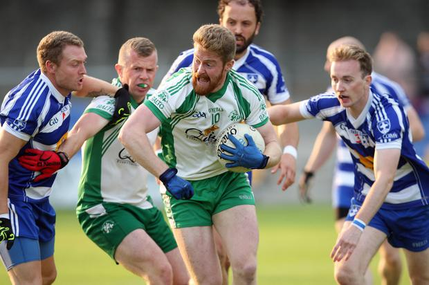 Kevin Murphy of Baltinglass in possession in a swarm of players
