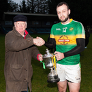 Kilcoole captain Daniel Kavanagh is presented with the Swan Cup