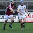 Peter Keane of Wicklow is chased by Emmet Corrigan of Westmeath during their Kehoe Cup match