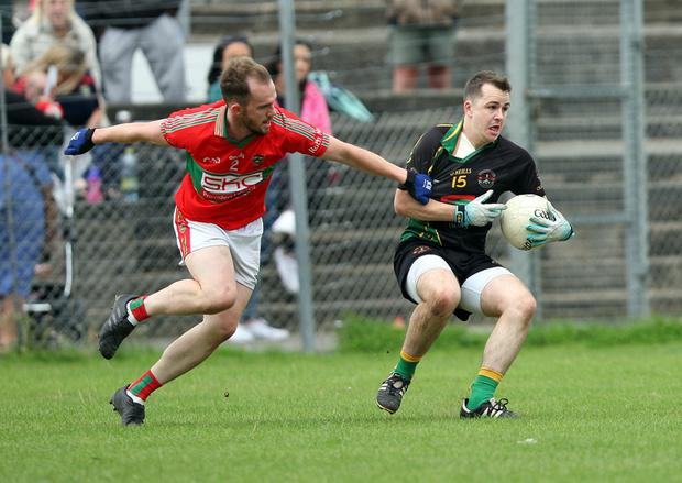 Seanie O'Keeffe of Hollywood is challenged by David Jameson of Rathnew