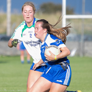 Anne Marie Keegan of AGB closes in on Lucy Dunne of St Pat's