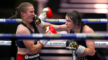 Katie Taylor, right, lands a blow on Delfine Persoon. Photo: Mark Robinson / Matchroom Boxing