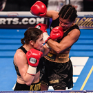 Katie Taylor, left, exchanges punches with Viviane Obenauf during their Super-Featherweight fight at the Manchester Arena