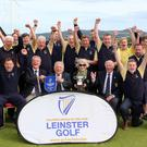 John Ferriter (Chairman, Leinster Golf, GUI) presenting Barry Massey, Captain of Greystones Golf Club with the Metropolitian Cup after their victory at Portmarnock
