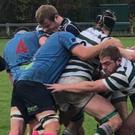 Conor Pearse of Greystones under pressure against Belfast Harlequins.