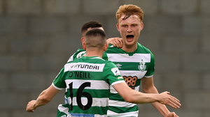 Liam Scales of Shamrock Rovers celebrates with team-mates Aaron Greene and Gary O'Neill, 16, after scoring their side's first goal during the  match against Dundalk. Photo by Stephen McCarthy/Sportsfile