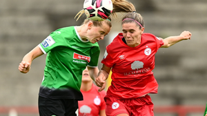 Claire Walsh in action for Peamount United on Saturday, battling against Shelbourne's Jamie Finn.
