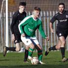 Alan Power comes away with possession for Wicklow Rovers