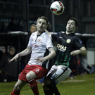 Ian Bermingham of St Patrick's Athletic and Karl Moore of Bray Wanderers keep their eyes on the ball