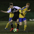 Newtown's Dillon Carthy and Seaview's Nevan O'Sullivan battle for possession